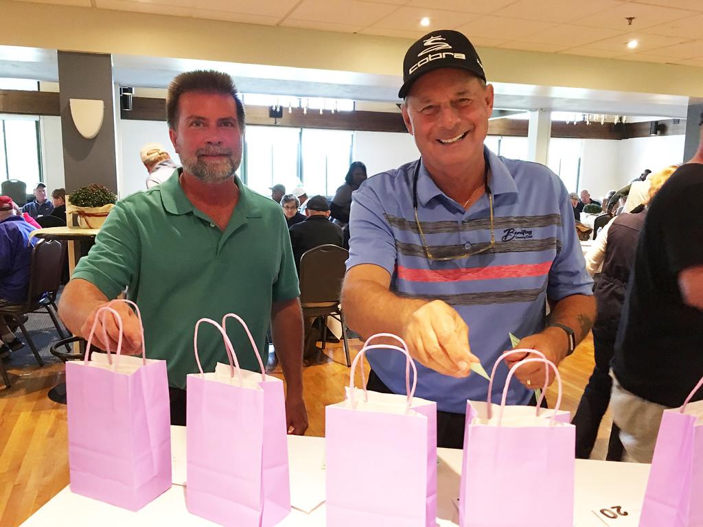 . Alex Nemethy of Salem, N.H., and Ron Lafond of Salisbury put raffle tickets into bags.
