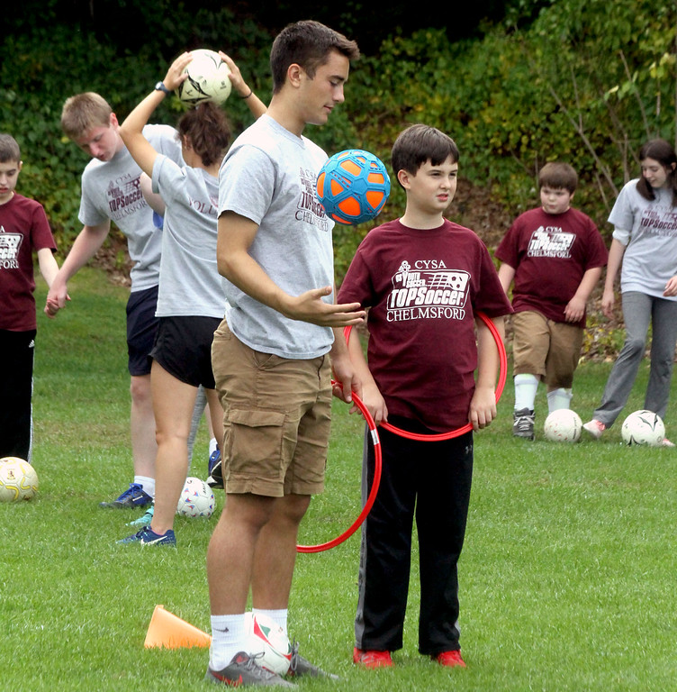 . Volunteers and special needs athletes doing drills at Top Soccer camp in Chelmsford, in middle is volunteer Jack Fox 17, with player Colin Krochune 12 both from Chelmsford. SUN/David H. Brow