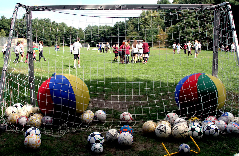 Volunteers and special needs athletes at the Top Soccer camp in Chelmsford. SUN/David H. Brow
