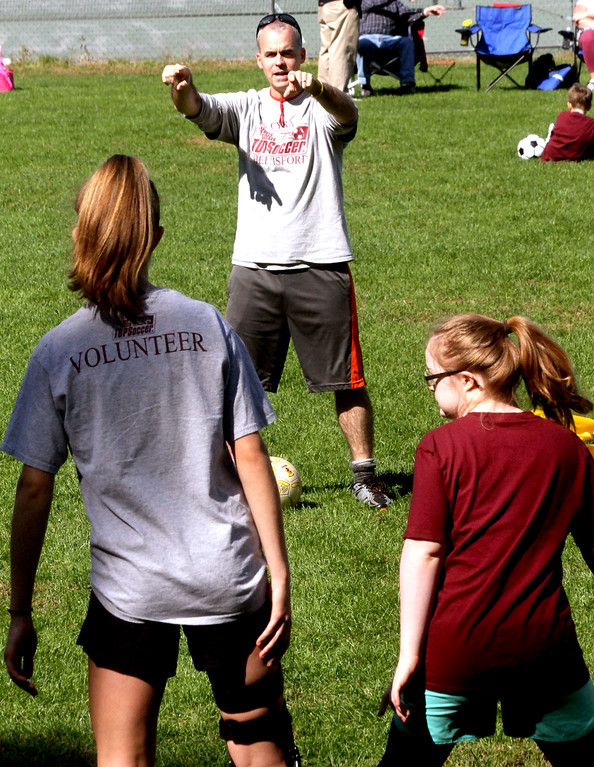 . Volunteer Mike Sexton working with special needs kids at the Top Soccer camp in Chelmsford. SUN/David H. Brow