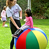 Volunteer Lisa Macedo 16, works with Alisha Joshi 3 1/2 at the Top Soccer camp. SUN/David H. Brow