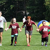 Playing games at the Top Soccer camp, in middle is camp director Abby Berry. SUN/David H. Brow