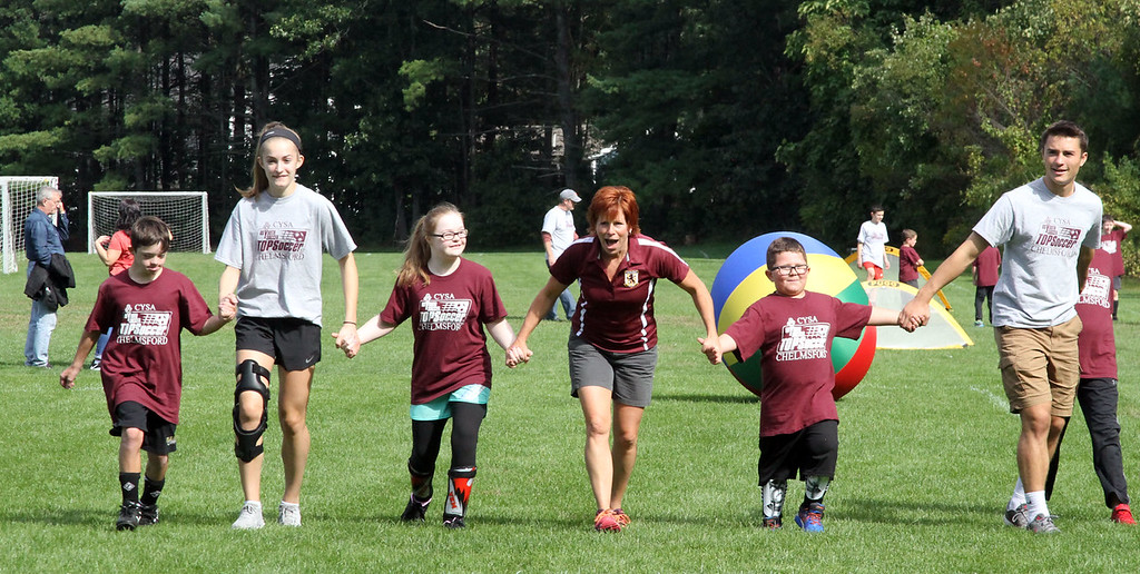 . Playing games at the Top Soccer camp, in middle is camp director Abby Berry. SUN/David H. Brow