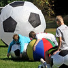 Volunteers and athletes break out soccer balls of all sizes at a Chelmsford Youth Soccer program for special needs kids. SUN/David H. Brow
