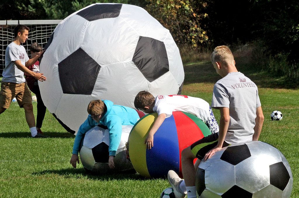 . Volunteers and athletes break out soccer balls of all sizes at a Chelmsford Youth Soccer program for special needs kids. SUN/David H. Brow