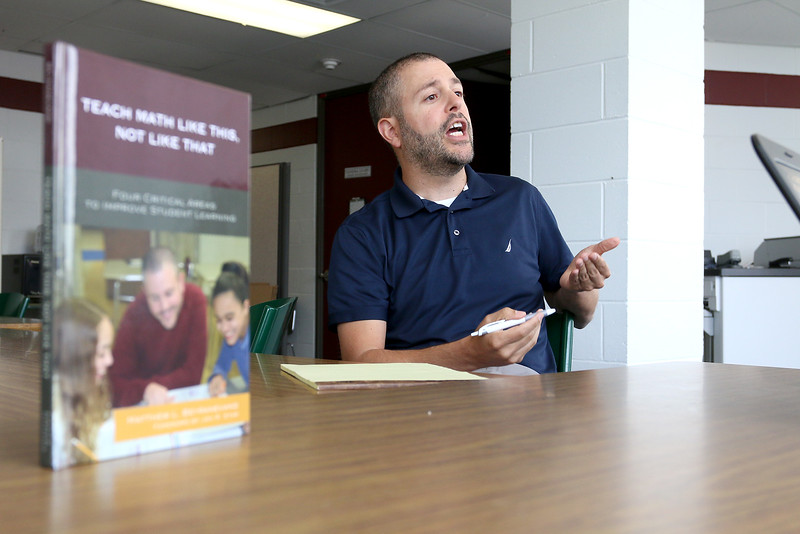 "Matthew Beyranevand, math and science curriculum coordinator for Chelmsford schools, known for his fun ""Math with Matthew"" videos, has written a new math education book, ""Teach Math Like This, Not Like That,"" that comes out next week. He talked about his book at Chelmsford High School on Monday, June 26, 2017. SUN/JOHN LOVE"