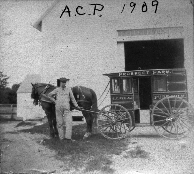 77 Westford Street 1909, Barn and Arnold C Perham with milk wagon closeup