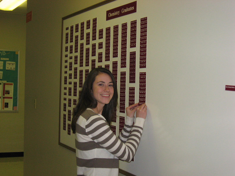 Brittany putting her name on the Chem Graduates board.