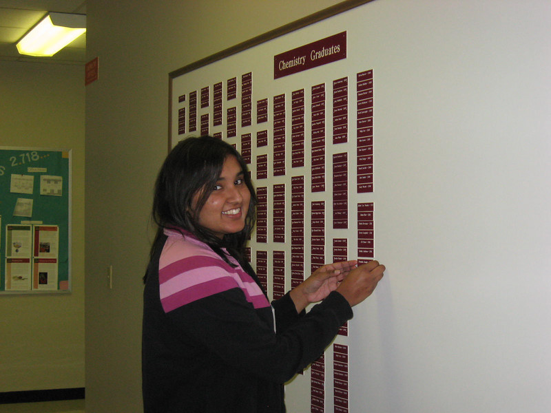 Twinkle putting her name on the Chem Graduates board.