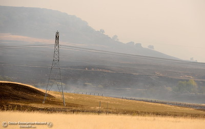 Blackened grass is seen from Hwy. 70 looking toward Table Mountain as firefighters battle the Cherokee Fire Monday Oct. 9, 2017. (Bill Husa -- Enterprise-Record)