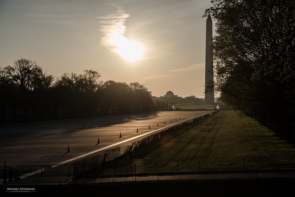 Lincoln Memorial Reflecting Pool and the Washington Monument with morning sun.