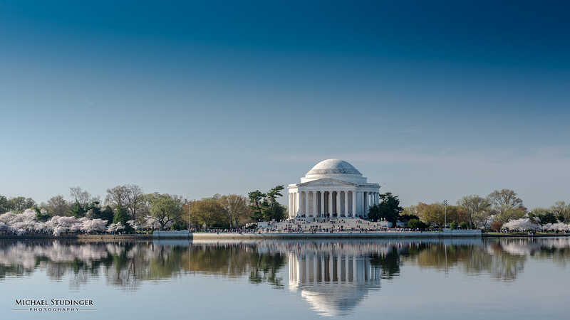 Cherry blossoms around the Tidal Basin and the Thomas Jefferson Memorial in Washington, D.C. during peak bloom.