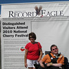 "Sunday, July 4, 2010 : Visit the Record-Eagle booth at the Cherry Festival and get your ""Distinguished Visitor"" photo taken! Download your photo here for free, or buy a reprint.