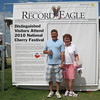 "Tuesday, July 6, 2010 : Visit the Record-Eagle booth at the Cherry Festival and get your ""Distinguished Visitor"" photo taken! Download your photo here for free, or buy a reprint.  To download your photo: Click the thumbnail image, and once the larger photo loads, right-click on the image and choose the Save option.  To purchase a reprint: Click the thumbnail image, and once the larger photo loads, click the Buy button above the photo to the right."