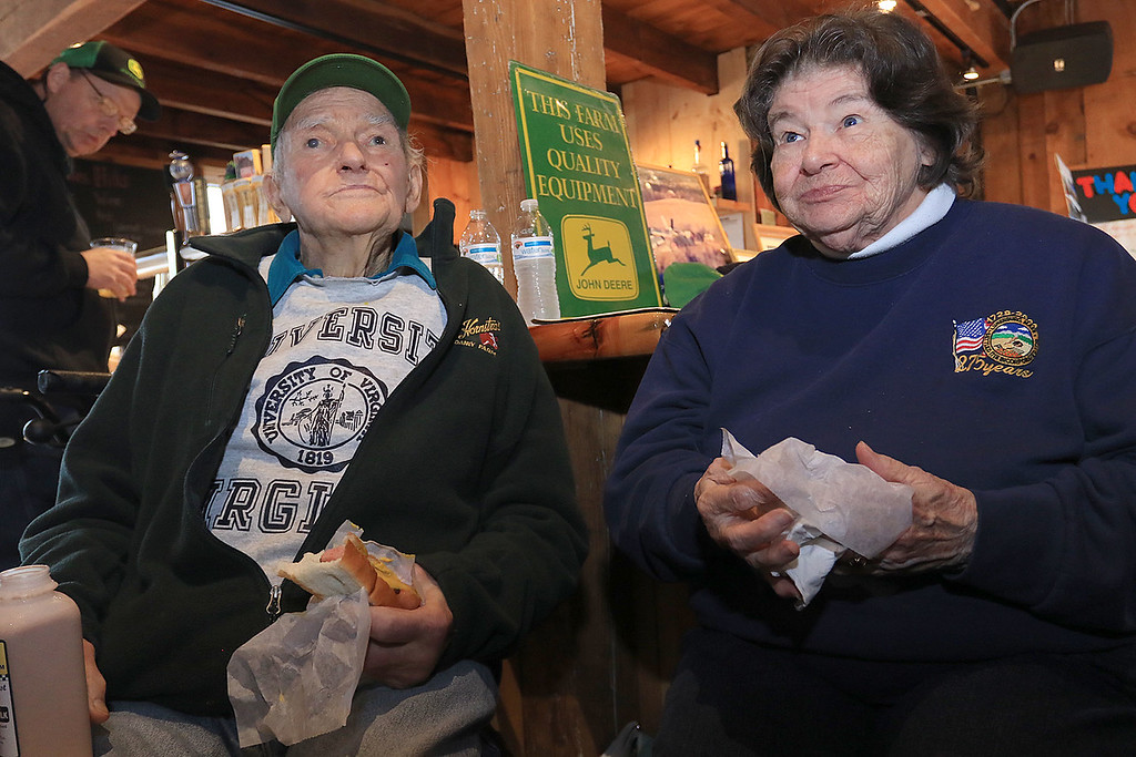 . The Lunenburg Lion\'s Club held a fundraiser for Cherry Hill Farm in Lunenburg on Saturday providing food, games, and music at Hollis Hills Farm in Fitchburg. Owner of Cherry Hill Farm Doug and marilyn MacMillan at the fundraiser. SENTINEL & ENTERPRISE/JOHN LOVE
