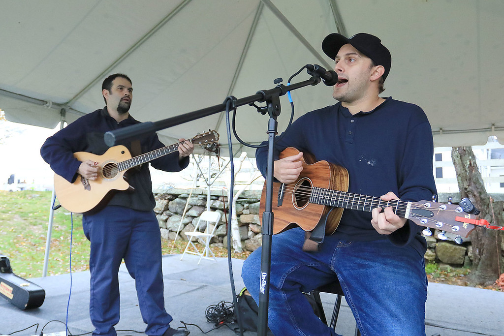 . The Lunenburg Lion\'s Club held a fundraiser for Cherry Hill Farm in Lunenburg on Saturday providing food, games, and music at Hollis Hills Farm in Fitchburg. Entertaining the crowd at the fundraiser was the group The Dirty Salesmen. From left in the groups is Gabriel Guile and Cory Bazillion. SENTINEL & ENTERPRISE/JOHN LOVE