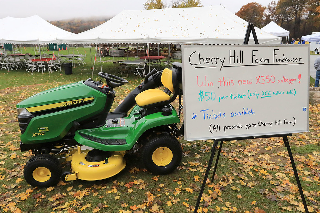 . The Lunenburg Lion\'s Club held a fundraiser for Cherry Hill Farm in Lunenburg on Saturday providing food, games, and music at Hollis Hills Farm in Fitchburg. At the fundraiser they had this X350 tractor as one of the raffle prizes. SENTINEL & ENTERPRISE/JOHN LOVE