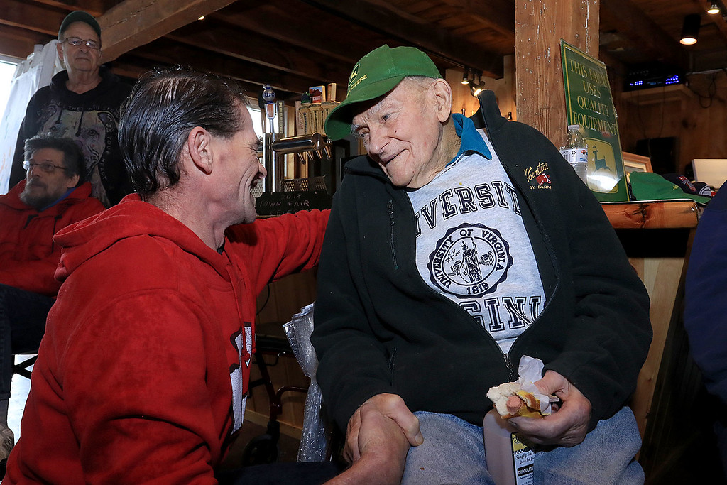 . The Lunenburg Lion\'s Club held a fundraiser for Cherry Hill Farm in Lunenburg on Saturday providing food, games, and music at Hollis Hills Farm in Fitchburg. Owner of Cherry Hill Farm Doug MacMillan chats with son Russell at the fundraiser. SENTINEL & ENTERPRISE/JOHN LOVE