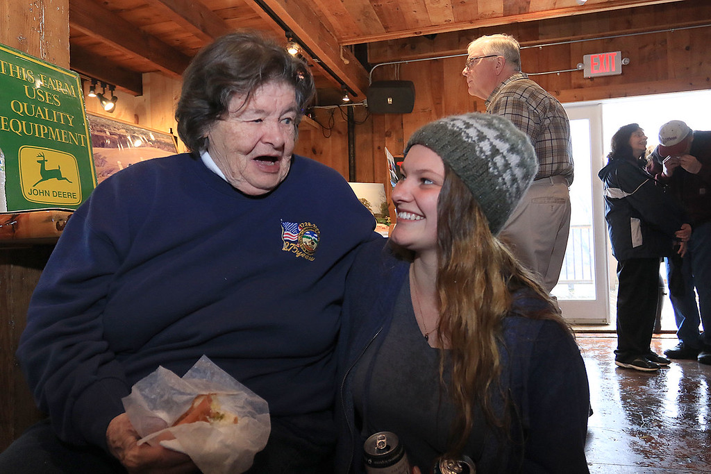 . The Lunenburg Lion\'s Club held a fundraiser for Cherry Hill Farm in Lunenburg on Saturday providing food, games, and music at Hollis Hills Farm in Fitchburg. Owner of Cherry Hill Farm Marilyn MacMillan chats with her granddaughter Kathleen MacMillan at the fundraiser. SENTINEL & ENTERPRISE/JOHN LOVE