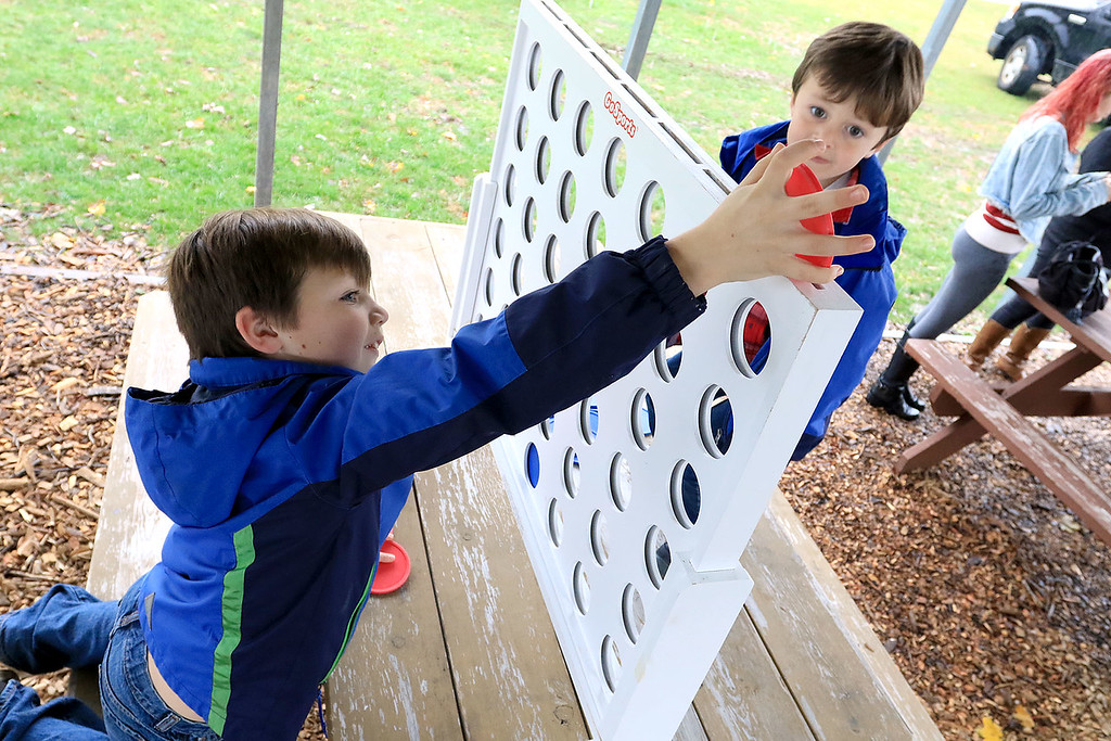 . The Lunenburg Lion\'s Club held a fundraiser for Cherry Hill Farm in Lunenburg on Saturday providing food, games, and music at Hollis Hills Farm in Fitchburg. Plauing connect four at the fundraiser is Robert MacMillan, 9, and his brother Steven MacMillan, 5. SENTINEL & ENTERPRISE/JOHN LOVE