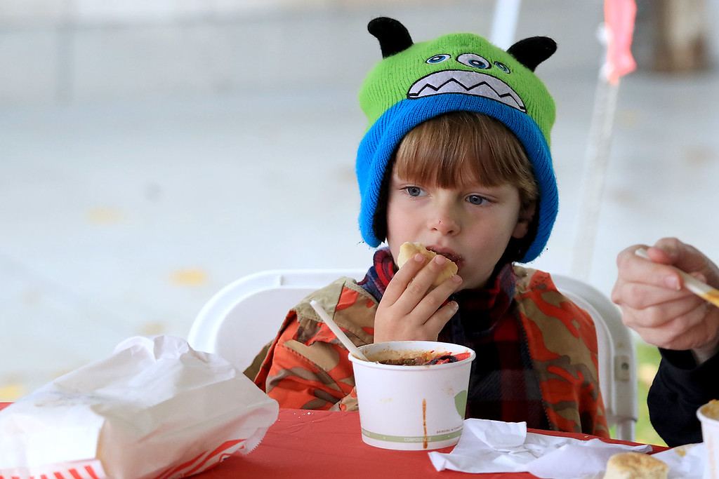. The Lunenburg Lion\'s Club held a fundraiser for Cherry Hill Farm in Lunenburg on Saturday providing food, games, and music at Hollis Hills Farm in Fitchburg. Enjoying the music and a hotdog at the fundraiser was Levi Greenough, 4, of Townsend. SENTINEL & ENTERPRISE/JOHN LOVE