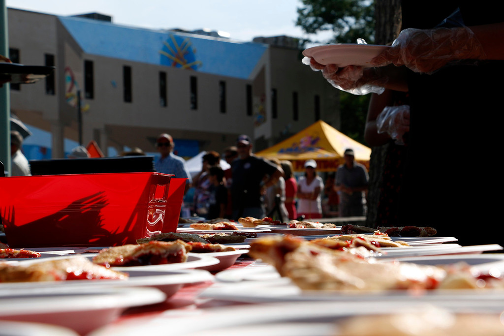 . 200 pies were displayed, sliced and served at the Cherry Pie Festival in Loveland, with a line of people to match on Saturday, July 8, 2017. (Michelle Risinger/ Loveland Reporter-Herald)