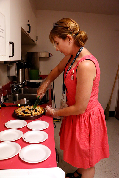 Jennifer Cousino dishes up a pie to be judged in the Cherry Pie Festival on Saturday, July 7, 2017. 32 pies were entered in the contest. (Michelle Risinger/ Loveland Reporter-Herald)