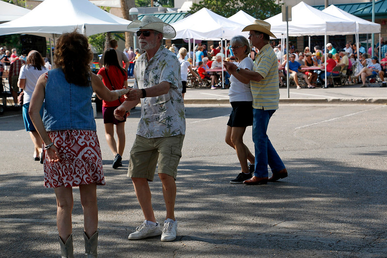 Robin Seymour, left, Ted Blakeslee, second from left, Eunice Hartpence, second from right, and Donn Smith, right, dance to live music and enjoy slices of pie at the Cherry Pie Festival in Loveland on Saturday, July 8, 2017. (Michelle Risinger/ Loveland Reporter-Herald)