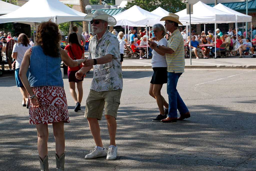 . Robin Seymour, left, Ted Blakeslee, second from left, Eunice Hartpence, second from right, and Donn Smith, right, dance to live music and enjoy slices of pie at the Cherry Pie Festival in Loveland on Saturday, July 8, 2017. (Michelle Risinger/ Loveland Reporter-Herald)