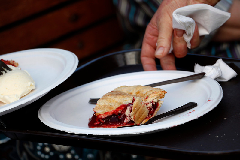 Loveland locals and visitors dig into 200 cherry pies at the Cherry Pie Festival on 5th and Licoln Ave. Saturday, July 8, 2017. (Michelle Risinger/ Loveland Reporter-Herald)