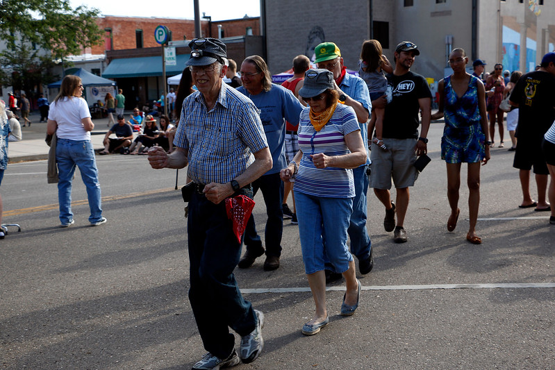 "Richard Wilson leads the people train as a live band plays Johnny Cash's ""Baby Ride Easy"" at the Cherry Pie Festival on Saturday, July 8, 2017. (Michelle Risinger/ Loveland Reporter-Herald)"