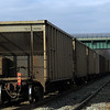 Last car of slow moving freight train finally passes