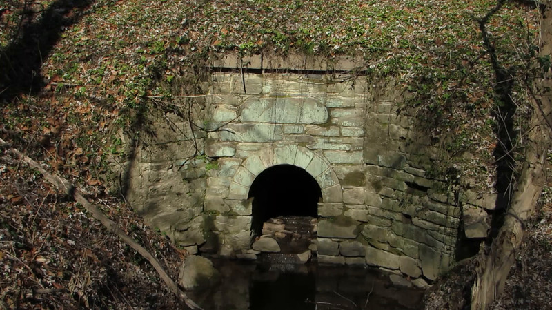 Water exits the towpath portal of Culvert 83 just as it has for 185 years