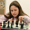 Kids play some chess at the Boys and girls Club of Fitchburg and Leominster on Wednesday afternoon. Madison Fluet, 11, of Leominster makes a move during her match. SENTINEL & ENTERPRISE/JOHN LOVE