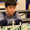 Kids play some chess at the Boys and girls Club of Fitchburg and Leominster on Wednesday afternoon. Anthony Muller, 11, of Leominster looks over the board and tires to decide what his move will be during his match. SENTINEL & ENTERPRISE/JOHN LOVE