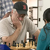 The Wachusett Chess Club held the Rocco R. Pasquale Memorial chess tournaments on Wednesday, September 4, 2019 at Fitchburg State University's McKay Campus School. Dave Couture of Westminster things about his next move during the tournament as his opponent Raaga Pulya of Acton looks over the board waiting for her move. SENTINEL & ENTERPRISE/JOHN LOVE