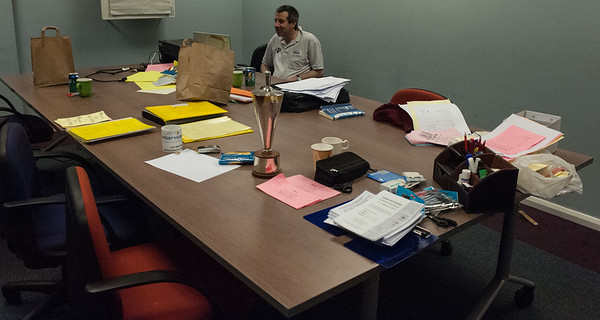 Neville Belinfante organises his desk in the arbiters office.