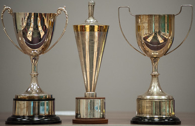 (l - r) Division Three, Two (The Richard Furness) and One trophies