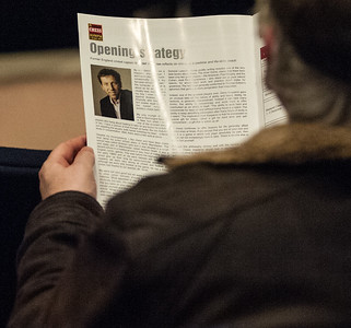 An audience member studies an article by Michael Atherton in the tournament programme.