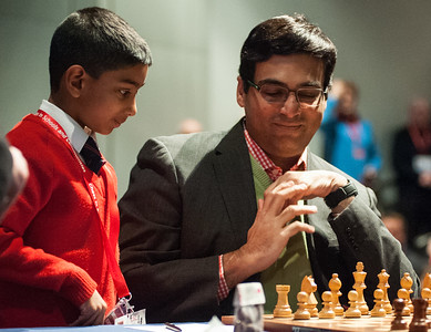 World Champion, Viswanathan Anand, receives advice on his first move