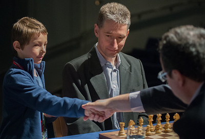 A young player makes the first move for GM Michael Adams