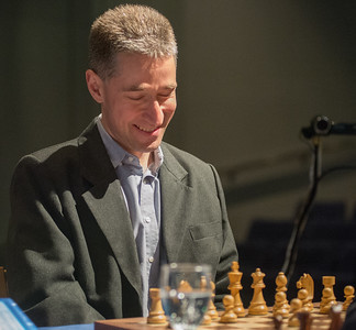 Michael Adams appears quite pleased with 1 e4