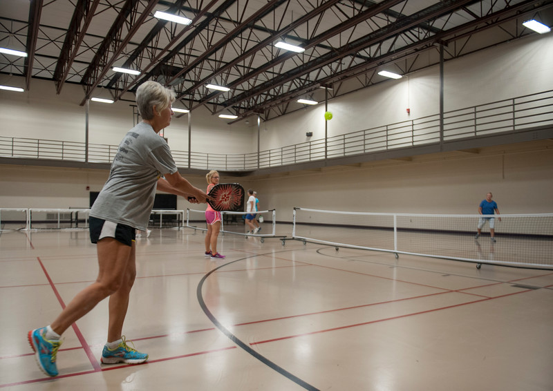 Patrons make use of available facilities and equipment at the Chester E. Peters Recreation Complex in Manhattan, Kansas on Sept. 4, 2018. The center includes several basketball courts, two indoor tracks, and various kinds of workout machines and weights. (Photo by Justin Wright | Collegian Media Group)