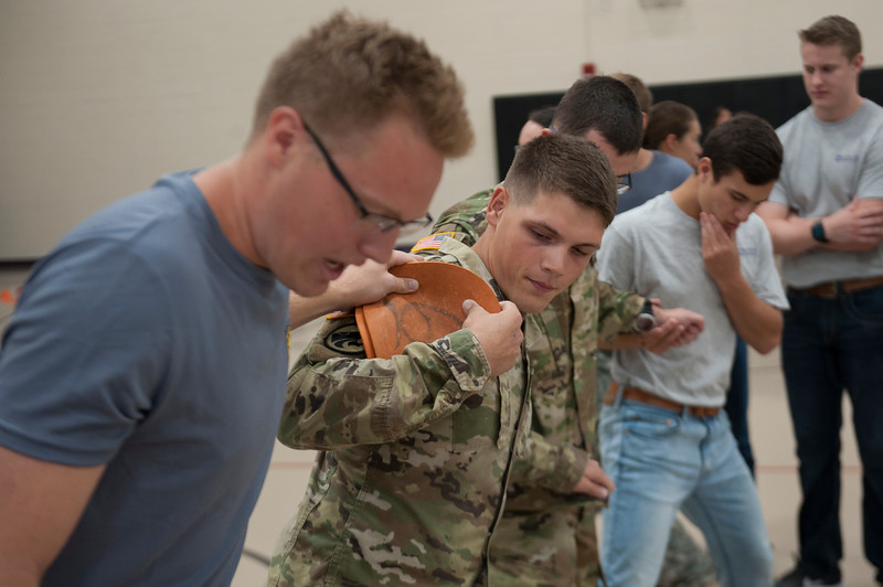 Members of the Kansas State Army ROTC participate in a team building exersice at the Chester E. Peters Recreation Complex in Manhattan, Kansas on Sept. 4, 2018. The course was lead by members of the K-State Challenge Course. (Photo by Justin Wright | Collegian Media Group)