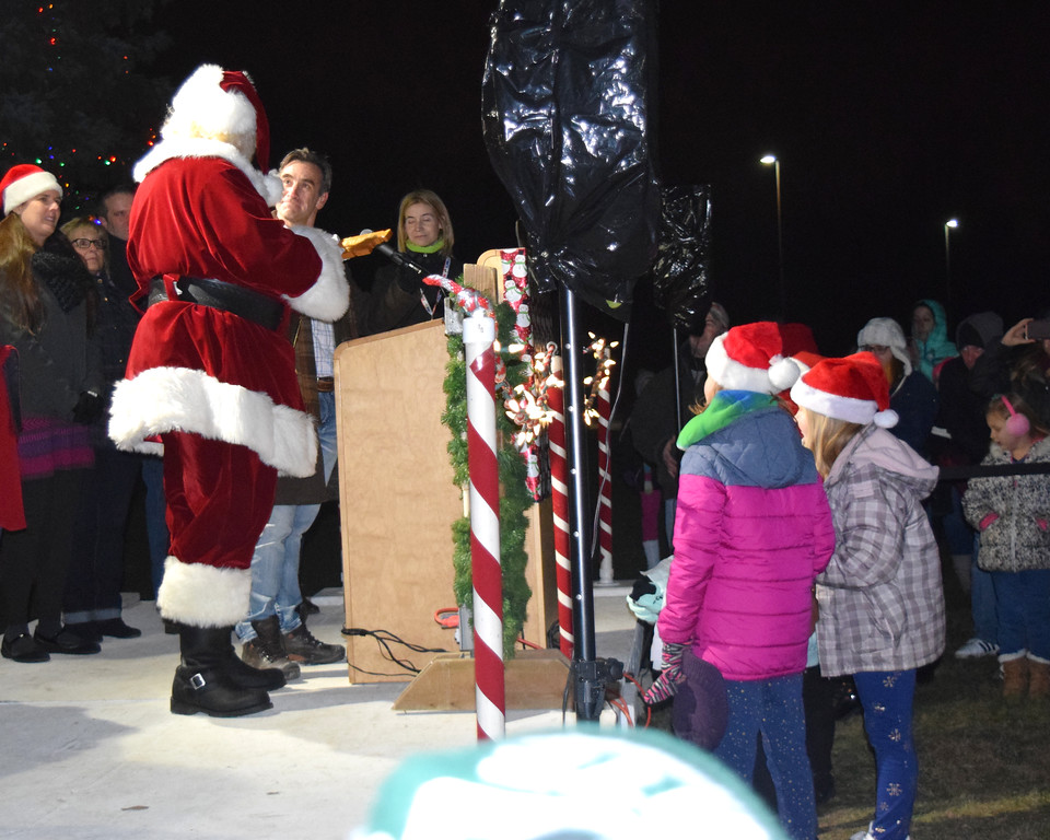 . Santa arrived in a horse-drawn carriage for Chesterfield Township\'s annual tree lighting ceremony on Dec. 7. The historical village was also open during the event. (Photos by Katelyn Larese)