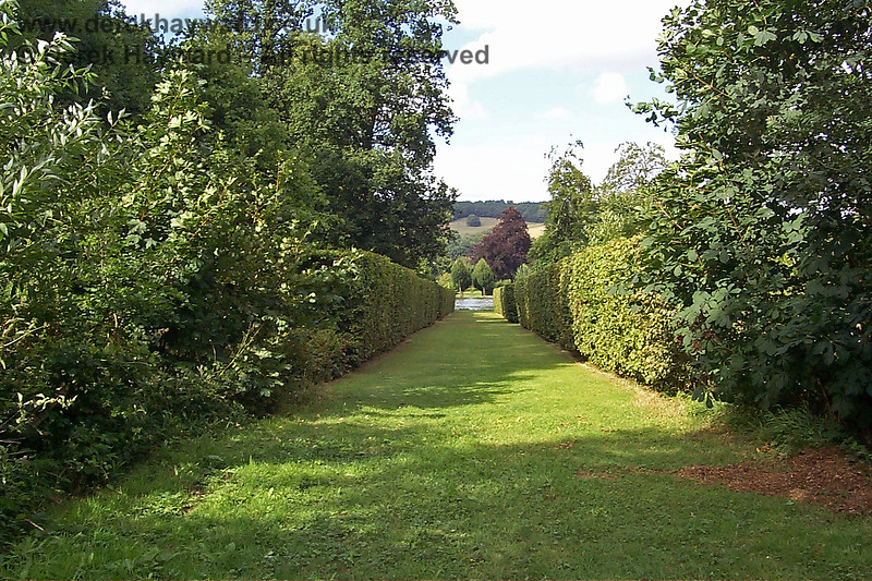 Sheltered walks within hedges lead from the lake up into the outer parts of the gardens.