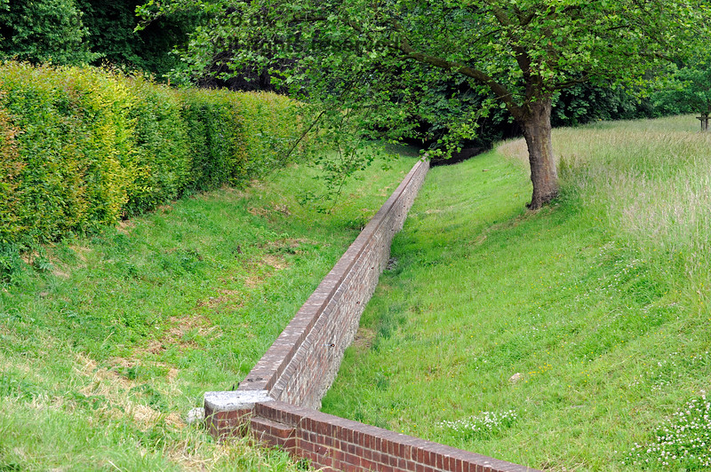 A low wall within a ditch prevents farm animals from entering the more formal gardens at Chevening.  22.06.2014  9675