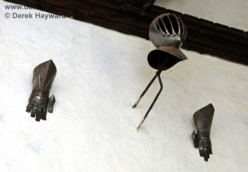 Items of funerary armour from the funeral procession of the first Earl Stanhope held on 17 February 1721.  Affixed to the wall are a helmet, gauntlets and spurs together with a gilt Earl's coronet.   Stanhope Chantry (Chapel), St Botolphs Church, Chevening.  19.06.2015  12835   [These items are replicas, the originals having been stolen on the night of 11/12 October 1983.  Thefts from churches are serious and the case remains open, despite the lapse of time.  Any information on the whereabouts of the originals, or about the persons responsible, should be provided to the Kent Police, or anonymously to Crimestoppers.  For the avoidance of doubt no one, in any country, can lawfully be in possession of the originals, or have any title to them.]