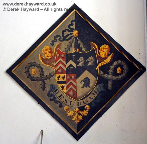 There are a total of ten hatchments either inside the Stanhope Chantry (Chapel), or within the main body of the church.  They depict the arms of various Stanhopes, Mansfield and Pitt.  Hatchments were hung at the entrance to the deceased's house at the time of death, carried at the funeral, and then placed in the church.    St Botolphs Church, Chevening.  19.06.2015  12848