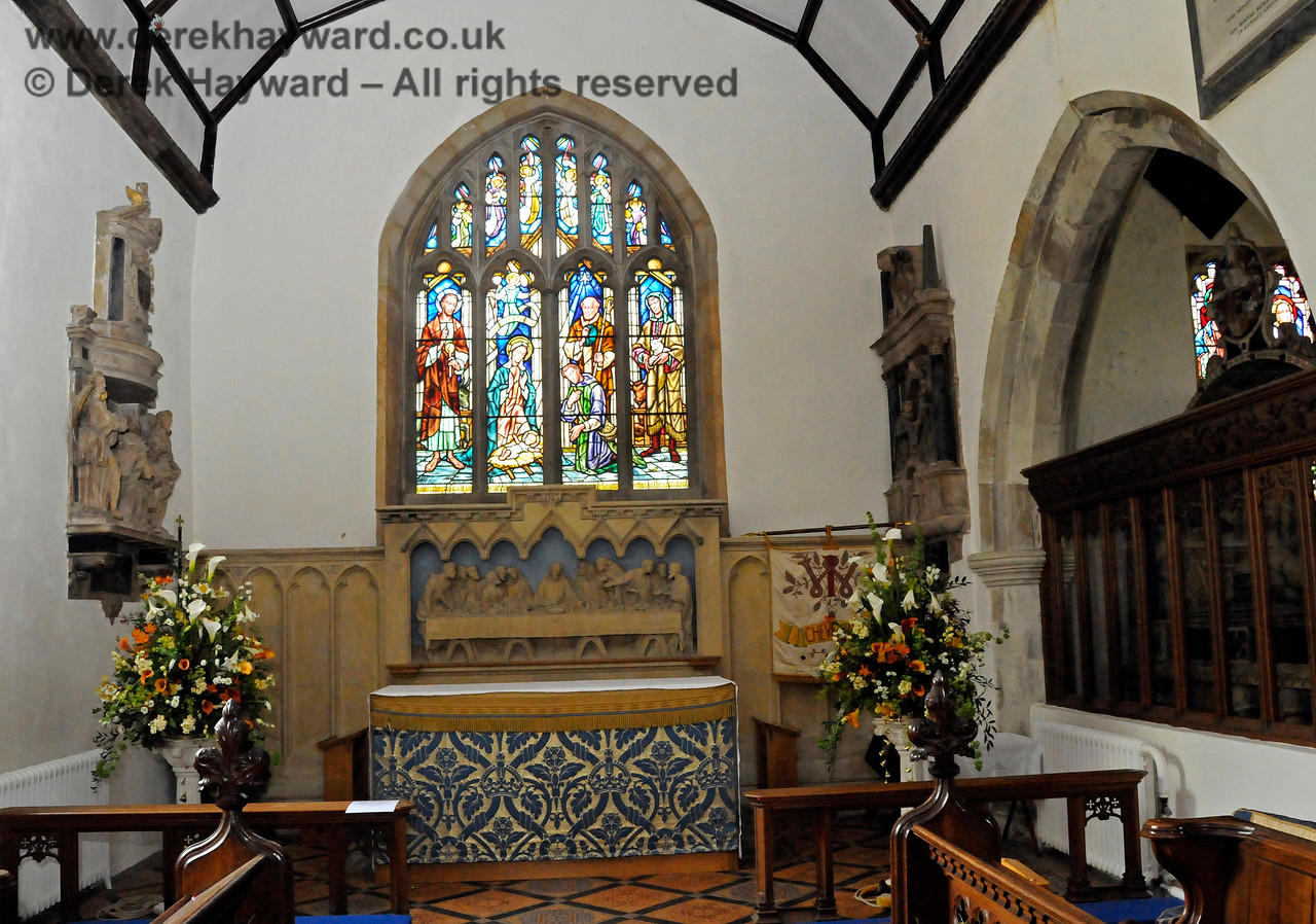 The Altar of St Botolphs Church, Chevening above which is a stone carving of the Last Supper.  The stained glass window is shown more clearly below.  19.06.2015  12838